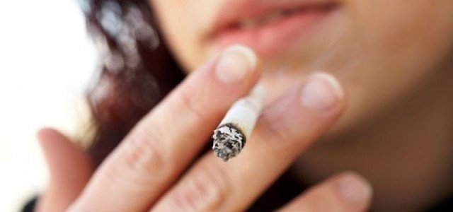 Picture of a young woman smoking a cigarette.